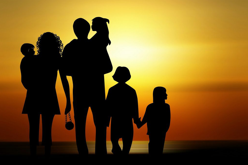 family at beach in shadow